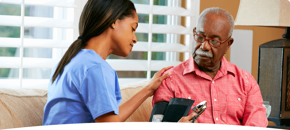 nurse checking old man's blood pressure
